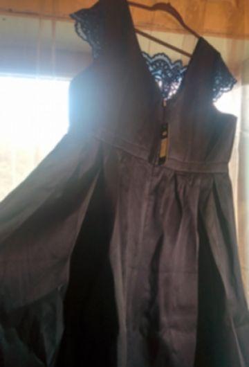 Ilga proginė suknelė
